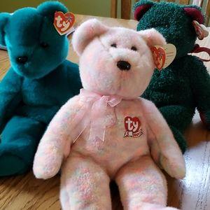3 Beanie baby teddy bears.